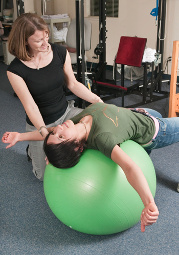 Photo of an instructor and client
